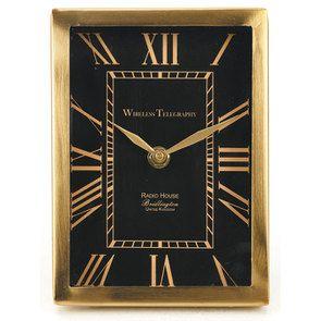 Horloge en métal noir et or à poser