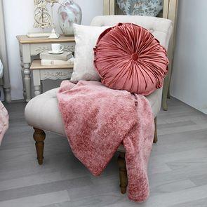 Coussin rond en velours rose plissé