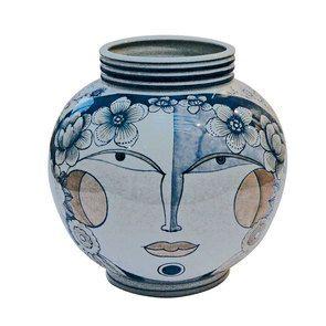 Vase boule bleu à motif visage