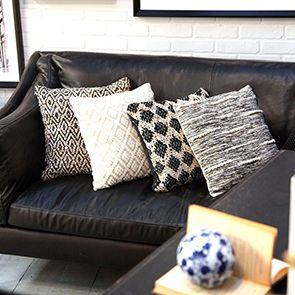Housse de coussin cuir tressé noir et blanc 40x40