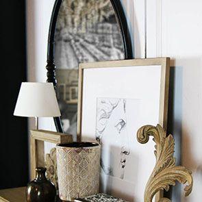 Miroir ovale en métal noir vieilli