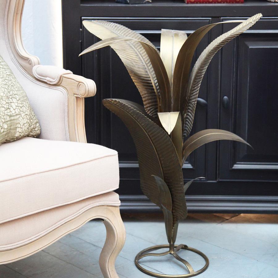 Statue feuilles de bananier en métal doré